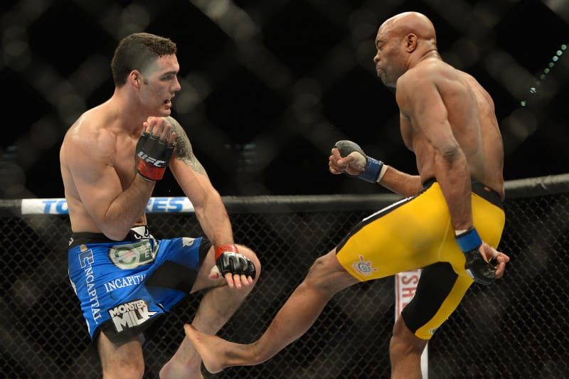 Dec 28, 2013; Las Vegas, NV, USA;   (EDITORS NOTE: graphic content) Anderson Silva (blue gloves) breaks his leg on a kick to Chris Weidman (red gloves) during their UFC middleweight championship bout at the MGM Grand Garden Arena. Mandatory Credit: Jayne Kamin-Oncea-USA TODAY Sports