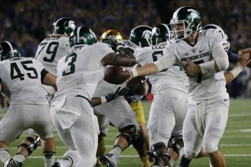 Wisconsin vs michigan state betting pick bears dolphins betting line