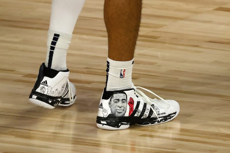 The shoes of Denver Nuggets' Jamal Murray are seen during the second  quarter of Game 5 of the team's NBA basketball first-round playoff series against the Utah Jazz, Tuesday, Aug. 25, 2020, in Lake Buena Vista, Fla. (Mike Ehrmann/Pool Photo via AP)