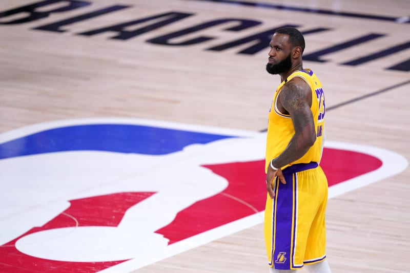 Los Angeles Lakers forward LeBron James stands on the court during the second half an NBA conference final playoff basketball game against the Denver Nuggets on Friday, Sept. 18, 2020, in Lake Buena Vista, Fla. (AP Photo/Mark J. Terrill)
