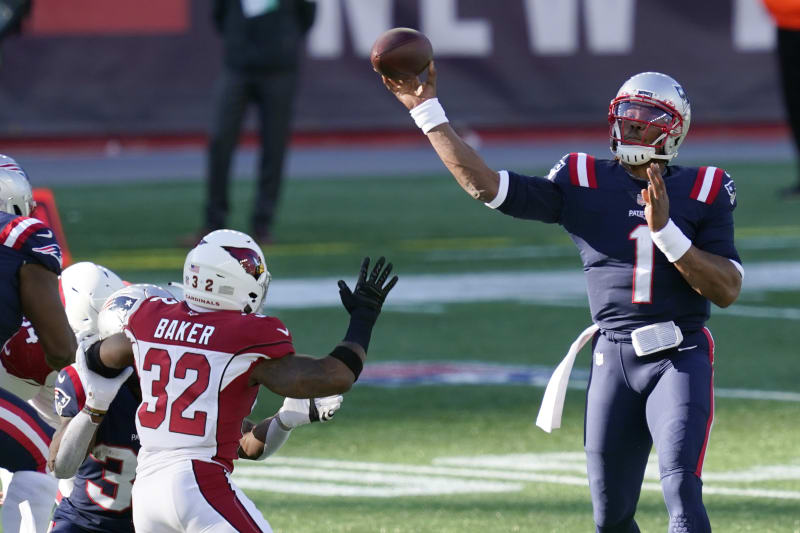 New England Patriots quarterback Cam Newton (1) passes under pressure from Arizona Cardinals safety Budda Baker (32) in the first half of an NFL football game, Sunday, Nov. 29, 2020, in Foxborough, Mass. (AP Photo/Elise Amendola)