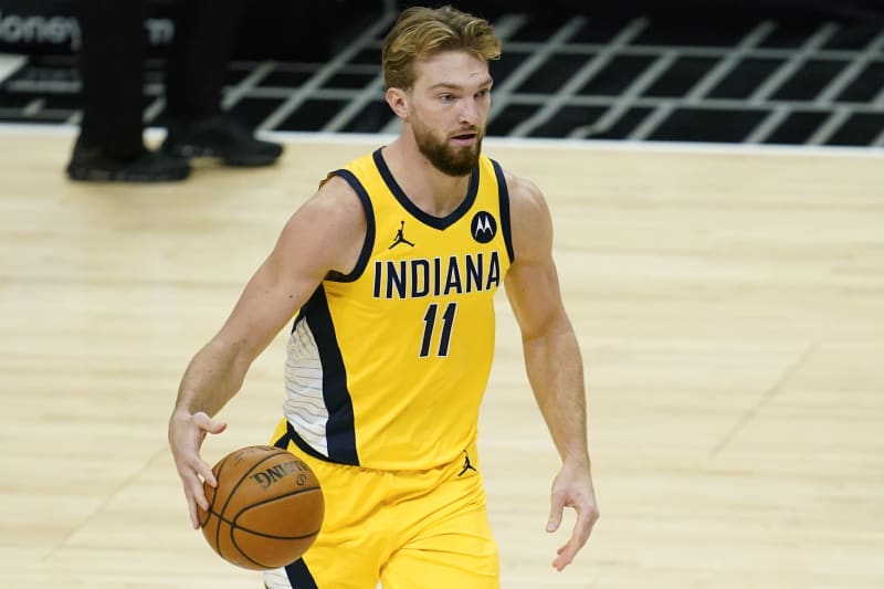 Indiana Pacers forward Domantas Sabonis (11) controls the ball during the fourth quarter of an NBA basketball game against the Los Angeles Clippers Sunday, Jan. 17, 2021, in Los Angeles. (AP Photo/Ashley Landis)
