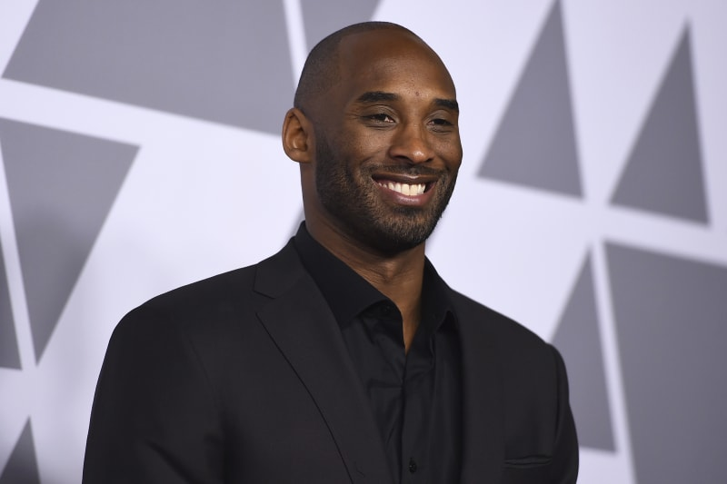 "FILE - In this Monday, Feb. 5, 2018, file photo, Kobe Bryant arrives at the 90th Academy Awards Nominees Luncheon at The Beverly Hilton hotel in Beverly Hills, Calif. Peyton Manning will be doing some analysis of NFL games this season after all. ESPN and Kobe Bryant's Granity Studios announced on Wednesday, Oct. 17, 2018, that Manning will be part of a football edition of the ""Detail"" franchise. The eight-episode series will be on the ESPN+ streaming service and debuts on Thursday, Oct. 18. (Photo by Jordan Strauss/Invision/AP, File)"
