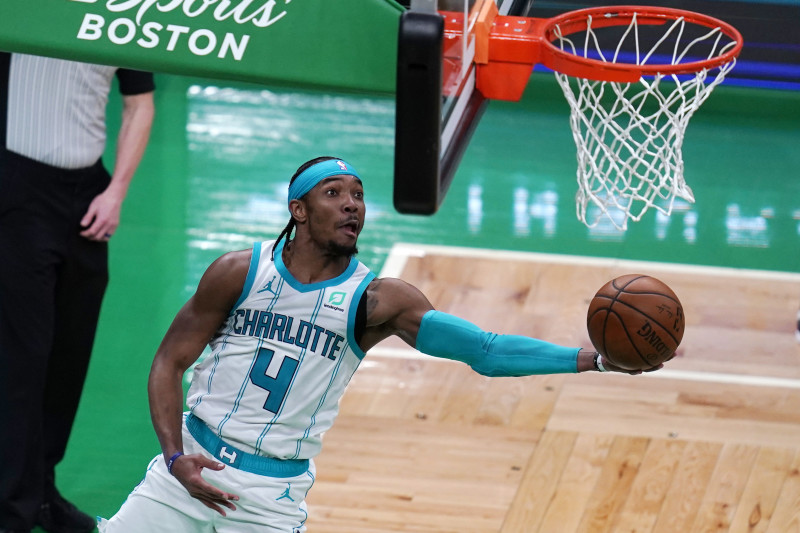 Charlotte Hornets guard Devonte' Graham (4) drives to the basket against the Boston Celtics during the second half of an NBA basketball game, Wednesday, April 28, 2021, in Boston. (AP Photo/Charles Krupa)