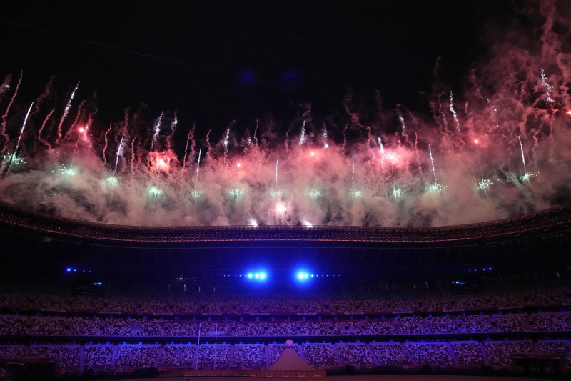 Fireworks explode during the opening ceremony in the Olympic Stadium at the 2020 Summer Olympics, Friday, July 23, 2021, in Tokyo, Japan. (AP Photo/David J. Phillip)